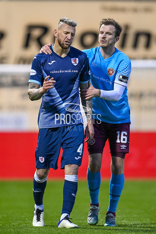 RED CARD Iain Davidson (#4) of Raith Rovers FC (left) is ushered from the field by Andy Halliday (#16) of Heart of Midlothian FC after being shown a red card during the SPFL Championship match between Raith Rovers and Heart of Midlothian at Stark's Park, Kirkcaldy, Scotland on 30 April 2021.