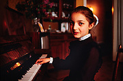 A young Georgian girl practices classical piano in her parents apartment in Tbilisi, Soviet Georgia . 1990