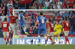 Tomer Hemed ( 3rd L ) of Brighton & Hove Albion has a shot on target which is saved by Dorus de Vries ( 2nd R ) of Nottingham Forest  - Mandatory byline: Paul Terry/JMP - 07966386802 - 07/08/2015 - FOOTBALL - Falmer Stadium -Brighton,England - Brighton v Nottingham Forest - Sky Bet Championship