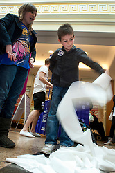 """Cadburys Spots vs Stripes Challenge Race Season Meadowhall Sheffield.7 Year Old Jack Hawkridge from Barnsley takes part in the """"Fastest Toilet Roller""""..2 April 2011.Images © Paul David Drabble"""