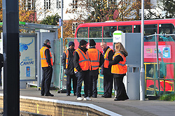 © Licensed to London News Pictures. 18/11/2016<br /> Rail staff watch trams running near Sandilands tram station where the line re-opened at 12.30pm for the first time since the Croydon tram crash last week. Photo credit :Grant Falvey/LNP