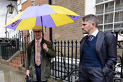 © Licensed to London News Pictures. 26/04/2012.LONDON, UK (L-R) Party leader Nigel Farage and GAWAIN TOWLER. Gawain Towler who is also a UKIP candidate and the party's top spin doctor has caused controversy today after making comments about a British Asian newspaper journalist. File picture dated 26/04/2012 as The UK Independence Party (UKIP) local election campaign was launched at St Stephen's Club, Central London. . Photo credit : Stephen Simpson/LNP