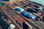 Nederland, Zuid-Holland, Rotterdam, 18-02-2015; Europoort met terrein van Ertsoverslagbedrijf Europoort. Opslag van ijzererts, steenkolen en andere grondstoffen voor de staalindustrie. Dintelhaven met duwbakken voor transport van erts en kolen. <br /> Europoort with terminals for dry bulk handling, ore and coal for German Steelmaking industry.<br /> luchtfoto (toeslag op standard tarieven);<br /> aerial photo (additional fee required);<br /> copyright foto/photo Siebe Swart