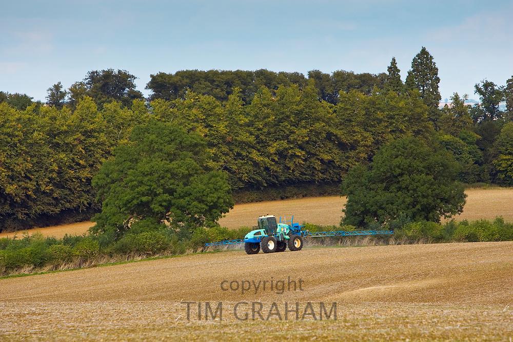 Farmer sprays his crops, Oxfordshire, United Kingdom