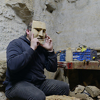 Mask builder in his workshop, carving traditional masks used in the Winter Solstice festivities of Trás-Os-Montes.