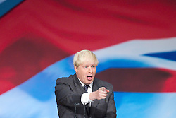 © Licensed to London News Pictures. 09/10/2012. Birmingham , UK . Boris Johnson , the Mayor of London , delivers his speech to the conference . Day 3 of the Conservative Party Conference at the International Convention Centre in Birmingham . Photo credit : Joel Goodman/LNP