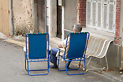 old man sitting waiting for visit to arrive France