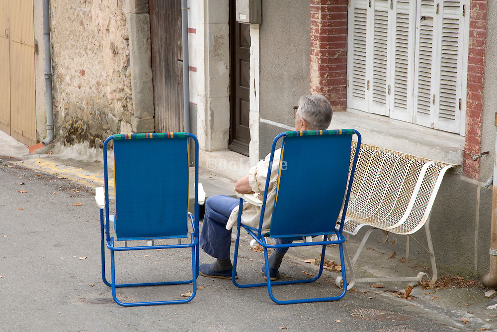 old man sitting waiting for visit to arrive France