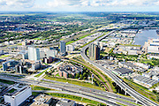 Nederland, Noord-Holland, Amsterdam, 27-09-2015; Amsterdam-West, Sloterdijk telepoort RIngweg A10-West, met Basisweg en Westrandweg A5 en spoorlijn richting Zaandam.<br /> Ringroad A5 en A10 and railroads, Amsterdam West. <br /> luchtfoto (toeslag op standard tarieven);<br /> aerial photo (additional fee required);<br /> copyright foto/photo Siebe Swart