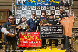 "Cherry's Company's Kaichiroh ""Kross"" Kurosu accepts the Retro Classic Cycles' Pick, W&W Germany's Pick and Chop and Roll Magazine Pick (from Giuseppe Roncen) for his 1948 Harley-Davidson Panhead at the Mooneyes Yokohama Hot Rod & Custom Show. Yokohama, Japan. December 6, 2015.  Photography ©2015 Michael Lichter."