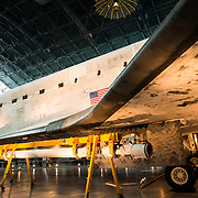 Underside of the left wing of the Discovery at the Smithsonian Air and Space Museum. The decommissioned Space Shuttle Discovery is on permanent display in the James S. McDonnell Space Hangar at the Smithsonian's National Air and Space Museum's Udvar-Hazy Center in Chantilly, Virginia, just outside Washington DC. The shuttle arrived at the museum on April 19, 2012, and replaces the Space Shuttle Enterprise.