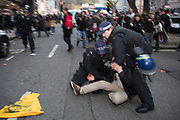 London, UK. Wednesday 19th November 2014. Student Assembly Against Austerity demonstration in protest at education spending cuts, tuition fees, and the resulting students debt. Demonstrator arrested by police. The protester was wrestled heavily to the ground while being arrested.