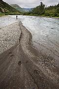 Bear tracks and fisherman, Kisaralik River, Alaska