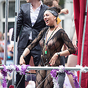 NLD/Amsterdam//20170805 - Gay Pride 2017, Vrouw in doorschijnent pakje