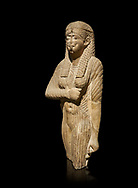Ancient Egyptian statue of a queen wearing a clinging dress, sandstone, Ptolemaic Period (332-30BC). Egyptian Museum, Turin. black background<br /> <br /> Drovetti Collection, Cat 1386 .<br /> <br /> If you prefer to buy from our ALAMY PHOTO LIBRARY  Collection visit : https://www.alamy.com/portfolio/paul-williams-funkystock/ancient-egyptian-art-artefacts.html  . Type -   Turin   - into the LOWER SEARCH WITHIN GALLERY box. Refine search by adding background colour, subject etc<br /> <br /> Visit our ANCIENT WORLD PHOTO COLLECTIONS for more photos to download or buy as wall art prints https://funkystock.photoshelter.com/gallery-collection/Ancient-World-Art-Antiquities-Historic-Sites-Pictures-Images-of/C00006u26yqSkDOM