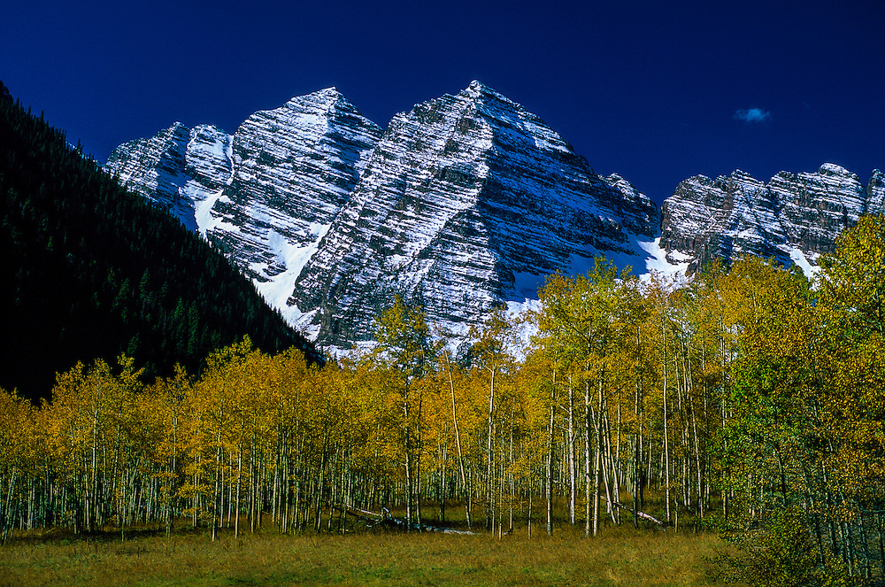 The snow capped peaks of the Maroon Bells with fall foliage, near Aspen, Colorado USA