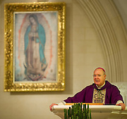 Bishop Kevin Farrell and the congregation of the Cathedral Shrine of the Virgin of Guadalupe celebrate the election of Pope Francis during Mass Sunday, March 17, 2013. (Cooper Neill/The Dallas Morning News)