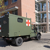 Army ambulence car arrives to a hospital during COVID19 corona virus pandemic in Budapest, Hungary on April 9, 2020. ATTILA VOLGYI