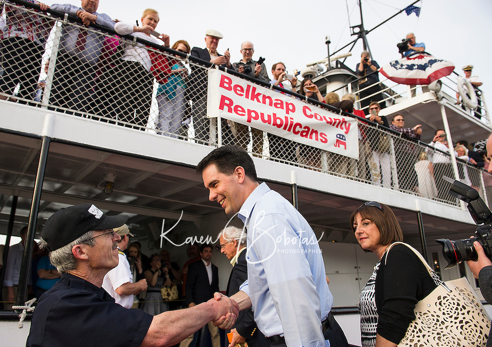 Wisconsin Governor Scott Walker is welcomed aboard the M/S Mt Washington for the Belknap County Republican Cruise on Friday evening.  (Karen Bobotas/for the Laconia Daily Sun)