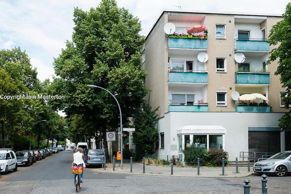 Street and social housing apartment building in Neukolln Berlin Germany