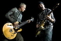 U2's Adam Clayton on Bass and The Edge  on lead Guitar perform with the band during their 2009  360 tour at Sheffield  Don Valley Stadium 20 August