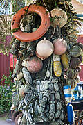 Old net floats decorate a tree along Hammer Slough in Petersburg, Mitkof Island, Alaska. Petersburg settled by Norwegian immigrant Peter Buschmann is known as Little Norway due to the high percentage of people of Scandinavian origin.