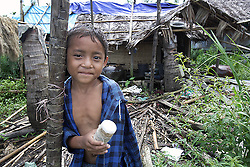 Khe Tha Ne (7)  in front of his damaged home.<br /> Ayeyarwaddy delta following Cyclone Nargis. Kan Nyi Naung village, Laputta, Myanmar.