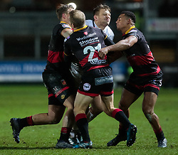 Ospreys' Dan Biggar is tackled by Dragons' Sarel Pretorius<br /> <br /> Photographer Simon King/Replay Images<br /> <br /> Guinness Pro14 Round 12 - Dragons v Cardiff Blues - Sunday 31st December 2017 - Rodney Parade - Newport<br /> <br /> World Copyright © 2017 Replay Images. All rights reserved. info@replayimages.co.uk - http://replayimages.co.uk
