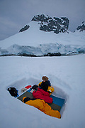 Faith D'Aluisio and Peter Menzel camping in the snow  on a small island in Leith Cove, Paradise Harbor, Antarctica Peninsula. MODEL RELEASED.