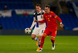 CARDIFF, WALES - Wednesday, November 18, 2020: Finland's Robin Lod (L) and Wales' Joe Rodon during the UEFA Nations League Group Stage League B Group 4 match between Wales and Finland at the Cardiff City Stadium. Wales won 3-1 and finished top of Group 4, winning promotion to League A. (Pic by David Rawcliffe/Propaganda)