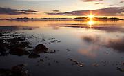 Sunset over a calm southeast Alaska ocean.