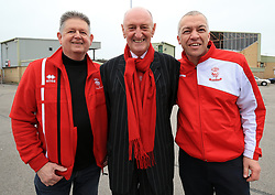 Lincoln City fans including ex manager Colin Murphy (centre) depart from Sincil Bank in Lincoln for the Emirates FA Cup match with Arsenal.