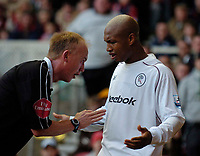 Photo. Jed Wee, Digitalsport<br /> Middlesbrough v Bolton Wanderers, Barclays Premiership, 07/11/2004.<br /> Bolton's El Hadji Diouf (R) is singled out by the Middlesbrough fans and referee P Walton following a catalogue of dives, fouls and time wasting.