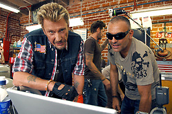 File photo : File photo : French designer Christian Audigier and Johnny Hallyday looks the pictures on a computer during a Photoshoot for clothing fashion line 'SMET' held in a Mar Vista tuning garage in Los Angeles, CA, USA on July 28, 2007. PHoto by Lionel Hahn/ABACAPRESS.COM