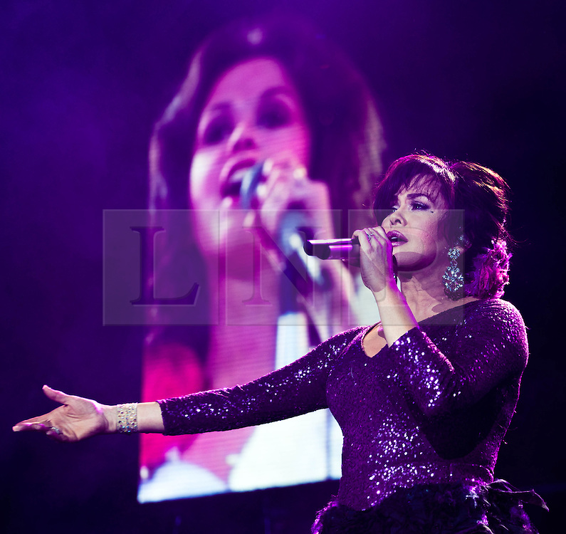 """© Licensed to London News Pictures. 20/01/2013. London, UK.   Marie Osmond of Donny and Marie Osmond performing live at The O2 Arena in front of a screen showing Marie when she was younger, on the opening night of their Donny & Marie Live tour Sunday 20 January 2013.  .Donald Clark """"Donny"""" Osmond (born December 9, 1957) is an American singer, musician, actor, dancer, radio personality, and former teen idol. Donny Osmond has also been a talk and game show host, record producer and author. In the mid 1960s, he and four of his elder brothers gained fame as The Osmonds on the long running variety program, The Andy Williams Show. Donny went solo in the early 1970s covering such hits as """"Go Away Little Girl"""" and """"Puppy Love""""...Olive Marie Osmond (born October 13, 1959) is an American singer, actress, doll designer, and a member of the show business family The Osmonds. Although she was never part of her family's singing group, she gained success as a solo country music artist in the 1970s and 1980s. .For over thirty-five years, Donny and Marie have gained fame as Donny & Marie, partly due to the success of their 1976-79 self-titled variety series, which aired on ABC. The duo also did a 1998-2000 talk show and have been headlining in Las Vegas since 2008.   Photo credit : Richard Isaac/LNP"""