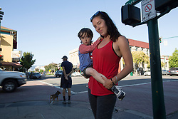 Heather Reed, a tenants' rights activist in Alameda, Calif., poses for a photograph with her son Colin Rider on Park Street, Wednesday, July 26, 2017. (Photo by D. Ross Cameron)
