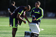 Swansea city player Ashley Williams (l) with Wayne Routledge .  Swansea city FC training at their training base in Landore  in Swansea, South Wales on Wed 23rd Oct 2013. The team are training ahead of the UEFA Europa league match v FC Kuban Krasnodar . pic by Andrew Orchard, Andrew Orchard sports photography,