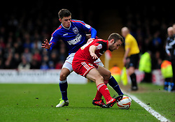 Bristol City's Liam Kelly holds up the ball from Ipswich Town's Aaron Cresswell - Photo mandatory by-line: Dougie Allward/JMP - Tel: Mobile: 07966 386802 26/01/2013 - SPORT - FOOTBALL - Ashton Gate - Bristol  -  Bristol City V Ipswich Town - Championship