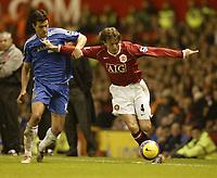 Photo: Aidan Ellis.<br /> Manchester United v Chelsea. The Barclays Premiership. 26/11/2006.<br /> United's Gabriel Heinze holds off Chelsea's Michael Ballack