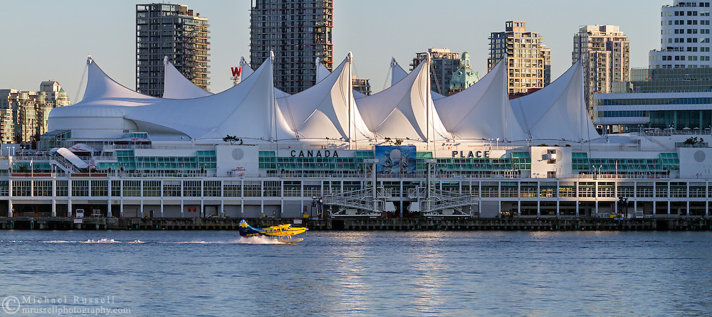 A Whistler Air floatplane lands in the water of Coal Harbour next to Canada Place in Vancouver, British Columbia, Canada