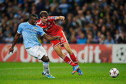 Bayern Midfielder Thomas Muller (GER) shoots as he is challenged by Man City Defender Micah Richards (ENG) during the second half of the match - Photo mandatory by-line: Rogan Thomson/JMP - Tel: Mobile: 07966 386802 - 02/10/2013 - SPORT - FOOTBALL - Etihad Stadium, Manchester - Manchester City v Bayern Munich - UEFA Champions League Group D.