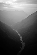 A river runs through the mountainous landscape of Ha Giang Province, Northern Vietnam, Southeast Asia