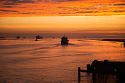Sunset orange glow landscape clouds water, North Sea shipping, Port of Rotterdam, Hook of Holland, Netherlands