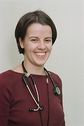 Portrait of young female doctor smiling with stethoscope around her neck,