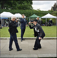 UK. London. The Village Green: From Blair to Brexit.<br /> A story on the relationship between the Media, Politicians and the public as they come together on College Green, a small patch of land next to The Houses of Parliament in Westminster. <br /> Photo shows publicity for a party on the day Gordon Brown took over as Prime Minister.<br /> Photo©Steve Forrest/Workers' Photos
