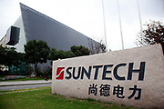 A company sign stands at Suntech Power Holdings Co.'s factory in Wuxi, Jiangsu Province, China, on Wednesday, Nov. 16, 2011. Suntech is  the world's biggest maker of silicon-based solar panels while China as a whole dominates the manufacturing of solar power panels.