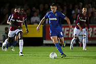 AFC Wimbledon midfielder Anthony Hartigan (8) dribbling during the EFL Carabao Cup 2nd round match between AFC Wimbledon and West Ham United at the Cherry Red Records Stadium, Kingston, England on 28 August 2018.