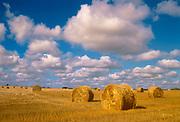 Bales and cumulus clouds<br />Shellbrooke<br />Saskatchewan<br />Canada