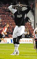 Photo: Ed Godden.<br /> Brentford v Swansea City. Coca Cola League 1. 12/09/2006. Swansea's Ezomo Iriekpen can't believe he missed the goal.