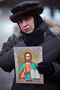 Moscow, Russia, 27/01/2011..A woman holds an icon at a memorial ceremony in central Moscow for the 35 people killed in the Domodedovo airport bombing.